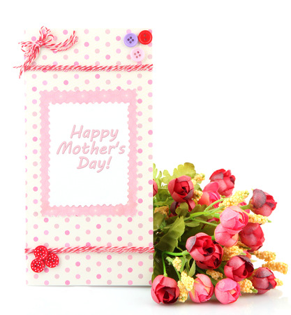 Beautiful hand made post card and flowers, isolated on white photo