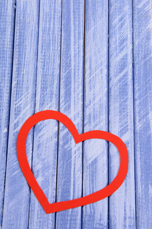 Paper hearts on wooden  background photo