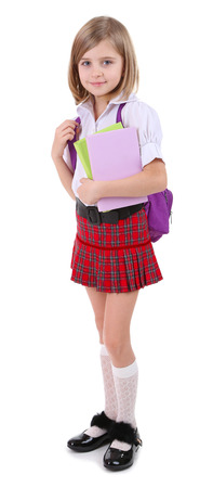 Beautiful little girl with backpack holding books isolated on white photo