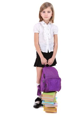 Beautiful little girl holding backpack isolated on white photo