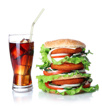 Huge burger and glass of cold drink, isolated on white photo