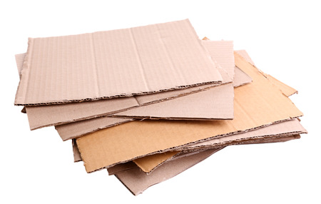 Stack of cardboard for recycling isolated on white Banco de Imagens