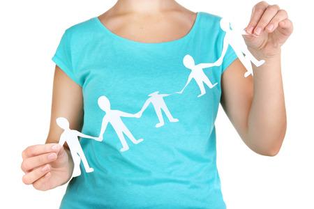 manos unidas: La gente de papel en las manos aisladas en blanco Foto de archivo
