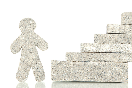 establishes: Building blocks with little man isolated on white Stock Photo