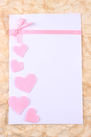 Beautiful romantic background with decorative hearts photo