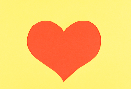 Paper heart on yellow  photo