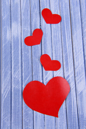 Paper hearts on wooden   photo