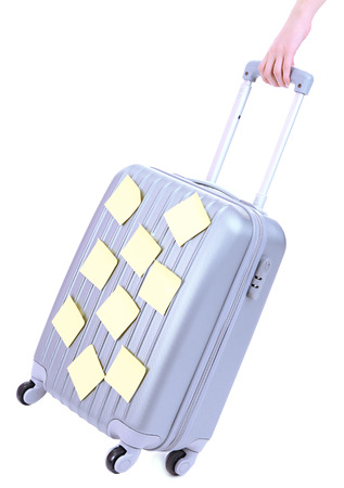 trundle: Suitcase with paper stickers isolated on white