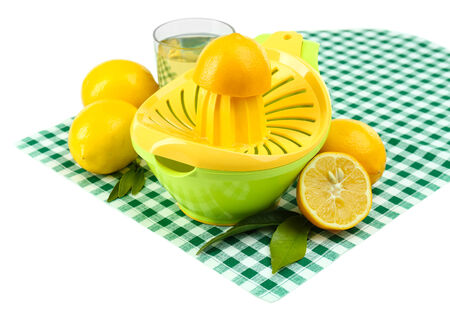 Citrus press and lemons isolated on white photo