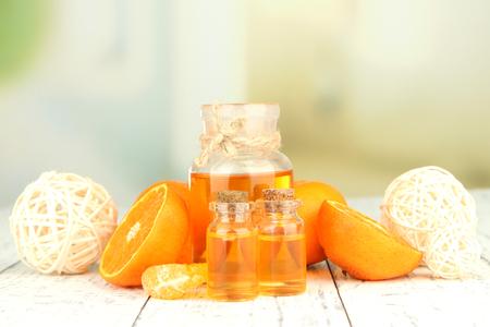 mandarin orange: Tangerine essential oil and tangerines on wooden table Stock Photo