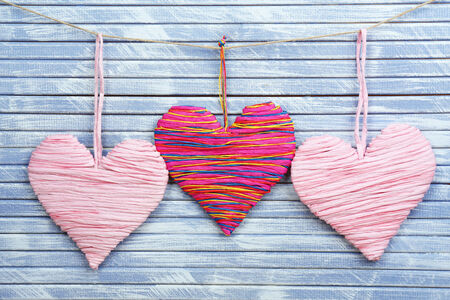 Decorative hearts on wooden  photo