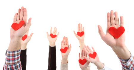 helping people: Hands with hearts,  isolated on white Stock Photo
