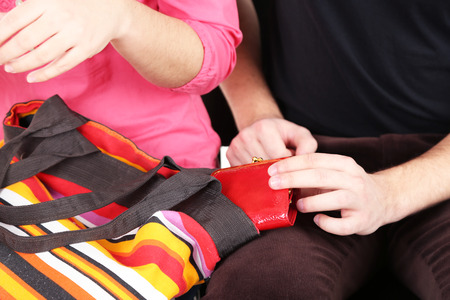inattention: Pickpocket are stealing wallet from bag, close up Stock Photo