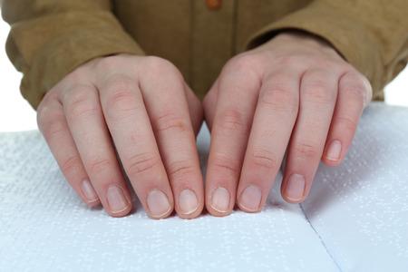 Blind woman read book written in Braille photo