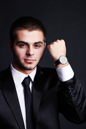 Handsome young man in suit on dark background Stock Photo - 26375927