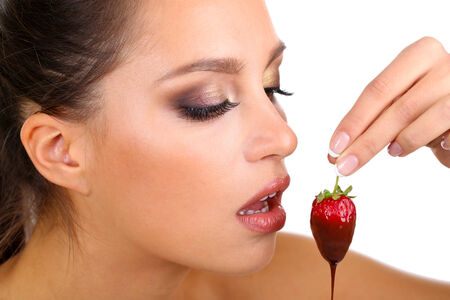 glutton: Portrait of beautiful young girl with strawberry in chocolate close up