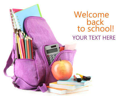 haversack: Purple backpack with school supplies isolated on white