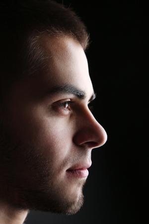 Handsome young man on dark background Stock Photo