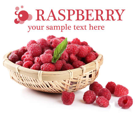 Ripe sweet raspberries in basket, isolated on white photo