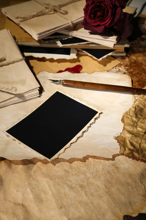 Composition with blank old photos, paper, letters on sackcloth  photo