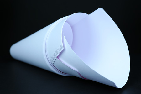 printed material: White paper on black close-up