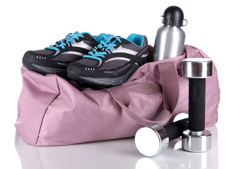 gym shoes: Sports bag with sports equipment isolated on white