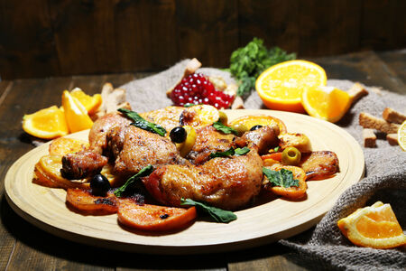Homemade fried chicken drumsticks with vegetables on wooden tray, on wooden  photo