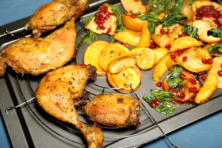 Homemade fried chicken drumsticks with vegetables on pan, on wooden Stock Photo - 26120010