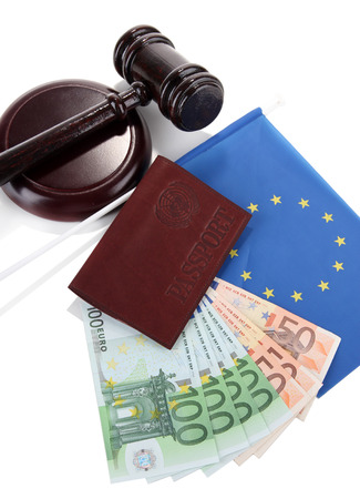 Gavel, money, passport and flag of Europe, isolated on white photo