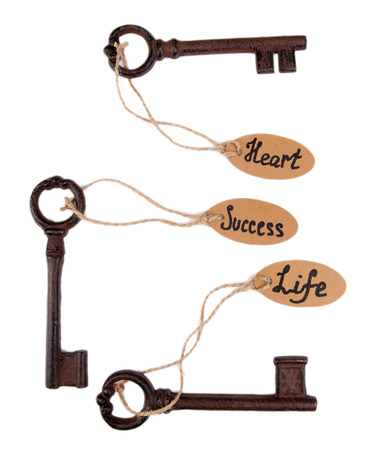 Keys to happiness, Conceptual. Isolated on white photo