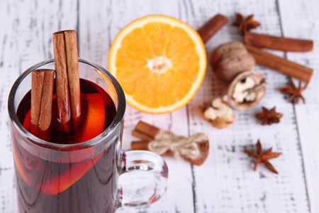 grog: Mulled wine with oranges and spices on wooden  Stock Photo