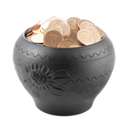 Golden coins in ceramic pot, isolated on white  photo