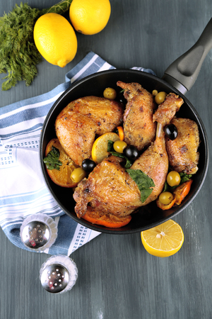 Homemade fried chicken drumsticks with vegetables on pan, on wooden background Stock Photo - 26330832