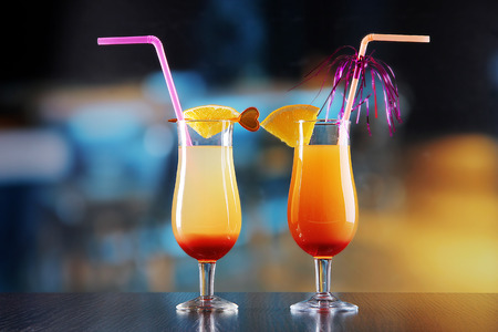 Glasses of tasty cocktails on bright  photo
