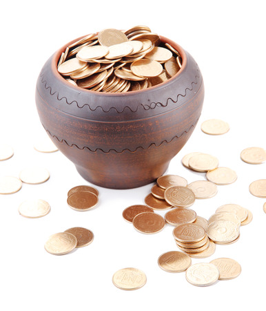 coin toss: Golden coins in ceramic pot, isolated on white background