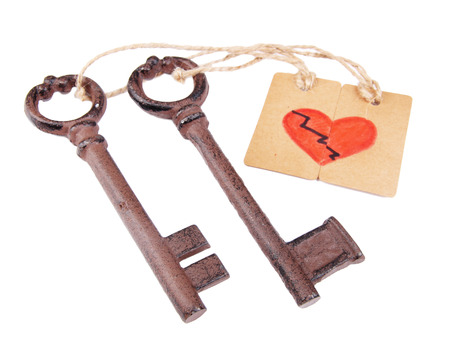 Keys to love, Conceptual photo. Isolated on white photo