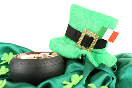 coins shot in golden color: Saint Patrick day hat, pot of gold coins and Irish flag, isolated on white