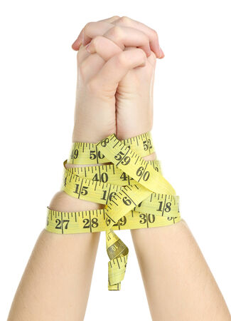 Woman hands with measuring tape isolated on white photo