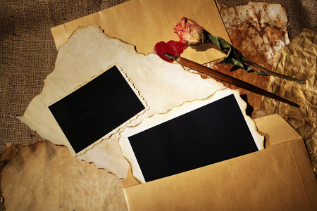 Composition with blank old photos, paper, letters on sackcloth background photo