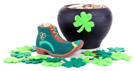Saint Patrick day boot, pot of gold coins and clover leaves, isolated on white photo