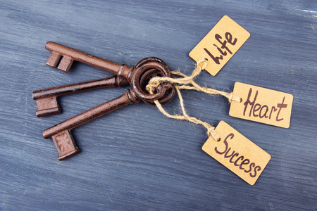 Keys to happiness, Conceptual photo On color wooden background Banco de Imagens