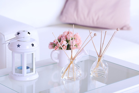 room air: Room air refreshers and decorations on table, close-up, on home interior background