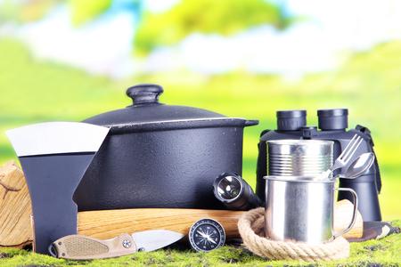 Equipment for trekking on green grass, on nature background photo