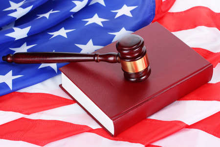 judge gavel and book on american flag background photo