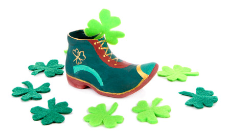 Saint Patrick day boot and clover leaves, isolated on white photo