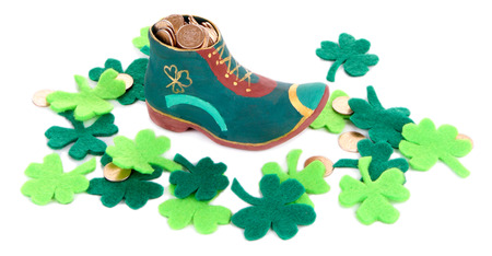 Saint Patrick day boot with gold and clover leaves, isolated on white photo