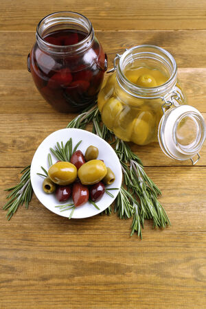 Tasty olives on wooden table photo