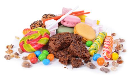 comida chatarra: Diferentes dulces aislados en blanco Foto de archivo