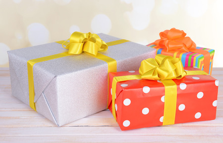 Gift boxes on table on light background photo