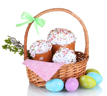 adorning: Beautiful Easter cakes in basket, colorful eggs and pussy-willow twigs isolated on white Stock Photo